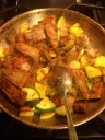 Sauce with fresh zucchini and beed short ribs.